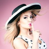 image of pinup girl  - Young beautiful blonde woman posing in pinup fashionable dress and elegant hat - JPG