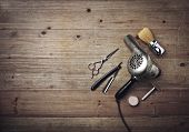 picture of barber razor  - Vintage Barber Equipment On Wood Background With Place For Text - JPG
