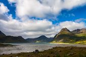 stock photo of fjord  - Scenic fjord on Lofoten islands with  towering mountain peaks - JPG