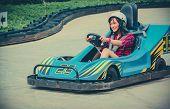 foto of karts  - Cute Thai girl is driving Go - JPG
