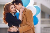 stock photo of hug  - A young couple in love - JPG