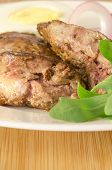 stock photo of liver fry  - Roasted chicken liver with vegetable on wooden background - JPG