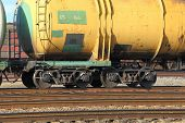 image of train-wheel  - Freight train passing by with blur - JPG