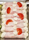 stock photo of buffet  - smorgasbord buffet food with ham rolls and tomato - JPG