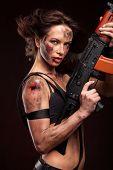 stock photo of ak-47  - Sexy blond woman killer holding automatic gun ak 47 - JPG