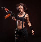 foto of ak-47  - Sexy blond woman killer holding automatic gun ak 47 - JPG