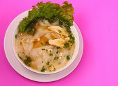 picture of glass noodles  - Glass noodle soup with chicken and beansprouts on a pink background - JPG