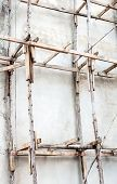 stock photo of scaffolding  - Wooden scaffolding of the unfinished building in  Thailand - JPG