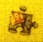 picture of yuan  - Dollar and Yuan on Puzzle - JPG