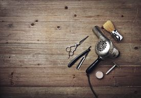 stock photo of barber razor  - Vintage Barber Equipment On Wood Background With Place For Text - JPG