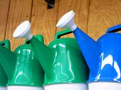 Red And Blue Watering Cans