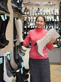 Mature Woman Chooses Wintry Shoes
