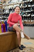 Woman Trying Shoes At Shoes Shop