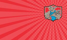 pic of minotaur  - Business card showing illustration of a minotaur bull mechanic looking to the side holding giant spanner set inside shield crest on isolated background done in cartoon style - JPG