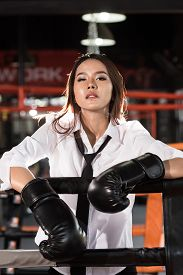pic of boxing  - Young Asian businesswoman with boxing glove on boxing ring - JPG