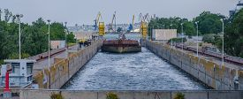 picture of barge  - a cargo barge in the lock of a water dam - JPG