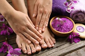 stock photo of pedicure  - Female feet at spa pedicure procedure - JPG