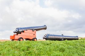 pic of cannon  - on the hill there is a light cannon and a cannon down - JPG