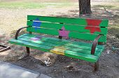 green bench with multi-colored stars