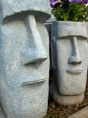 Easter Island Planters With Purple Flowers Growing