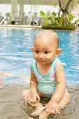 Cute Asian Baby At Swimming Pool