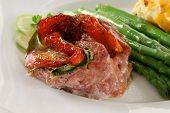 stock photo of flank steak  - Close up photo of stuffed baked flank steak - JPG