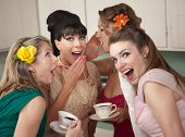 stock photo of foursome  - Group of four retro fashion housewives tell secrets in the kitchen - JPG