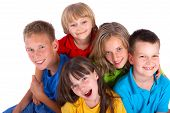 pic of happy kids  - A portrait of a group of happy kids isolated on a white background - JPG