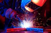 Welder erecting technical steel. Industrial steel welder in factory technical poster