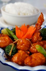 pic of crown green bowls  - A plate full of Thai chicken and broccoli sauteed in a spicy ginger brown sauce with a carrot crown garnish - JPG