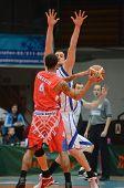 KAPOSVAR, HUNGARY - JANUARY 28: Jozsef Lekli (white 14) in action at a Hungarian Championship basketball game with Kaposvar (white) vs. Nyiregyhaza (red) on January 28, 2012 in Kaposvar, Hungary.