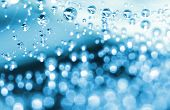 shining water droplets  looking as decorations with bokeh effect; winter &  new year theme