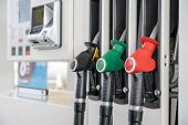 Red Green Black Color Fuel Gasoline Dispenser Background. Close-up Fuel Nozzles On Petrol And Diesel poster