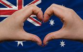 Over National Flag Of Australia Showed Heart And Love Gesture Made By Hands