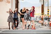 stock photo of young women  - Young beautiful punky teen girls strike poses for the camera - JPG