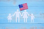 People Or Family Paper Shape With  Flag Of The United States Of America On Blue Wooden Background. U poster