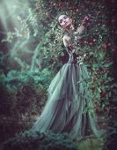 Beauty romantic model girl fashion posing in garden trees, enjoying nature in apple orchard. Beautif poster