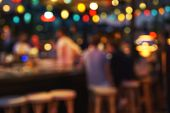 Blurred Background Of People Sitting At Restaurant, Bar Or Night Club With Colorful Lights Bokeh. Ab poster