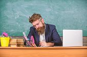 Paperwork Part Of Teachers Life. Teacher Bearded Hipster With Eyeglasses Sit In Classroom Chalkboard poster