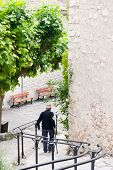 old man walking downstairs in Trigance France