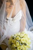 Bride Holding Her Bouquet In Lap