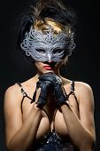 foto of incognito  - Close up shot of gorgeous Incognito woman in ancient style mask - JPG