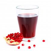 Fresh half of pomegranate juice on an isolated background