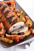 Roast pork with sage and thyme sauteed potatoes and spiced apple sauce