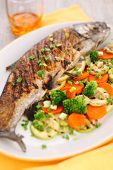 Grilled fish with vegetable (carrots, broccoli, zucchini)