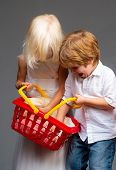 Girl And Boy Children Shopping. Couple Kids Hold Plastic Shopping Basket Toy. Buy With Discount. Fam poster