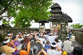 BALI-JANUARY 14:People praying in temple Pura Luhur Uluwatu on January 14, 2010 in Bali,Indonesia. Pura LuhurUluwatu is known as the guardian of the southwest and dedicated to the spirits of the sea.