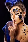 stock photo of iroquois  - girl with bright makeup unusual in blue - JPG