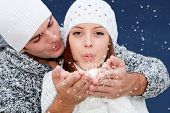 Couple Blowing And Making Chrismas Or Wishes
