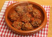 Spicy meatballs in tomato sauce.